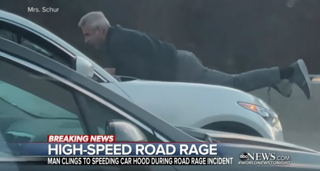 man clings to hood of suv in wild road rage incident video