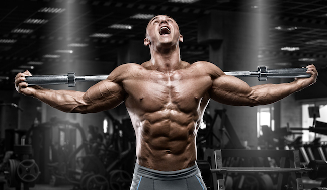 Muscular man in gym, shaped abdominal. Strong male naked torso abs, working out
