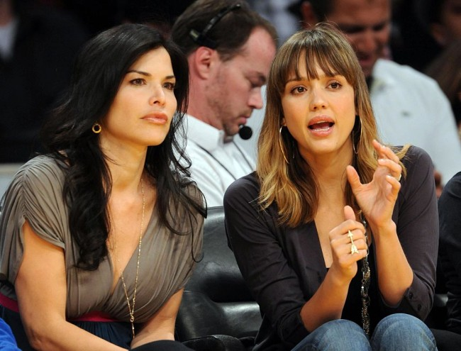 ©2009 GAMEPIKS Actress Jessica Alba (R) and television news anchor Lauren Sanchez sit courtside as they attend the Los Angeles Lakers/Houston Rockets NBA game at Staples Center in Los Angeles on April 4, 2009. The Lakers defeated the Rockets 93-81. XYZ (Photo by Philip Ramey/Corbis via Getty Images)