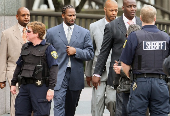 CHICAGO - MAY 09:  R&B singer R. Kelly (3rd-L) leaves the Cook County courthouse where jury selection is underway for his child pornography trial May 9, 2008 in Chicago, Illinois. Kelly has been accused of videotaping himself having sex with a girl believed to be as young as 13 years old. Kelly faces up to 15 years in prison if convicted.  (Photo by Scott Olson/Getty Images)