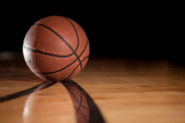 march madness basketball on court NCAA tournament college