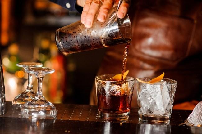 bartender pouring bourbon drink