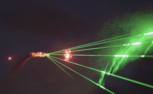 plane shoots lasers and fireworks