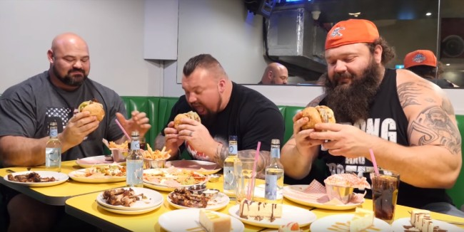 brian shaw (shawstrength) and eddie the beast hall go on airplane together do 20,000 calorie cheat day challenge