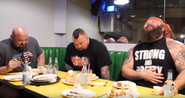 World Strongman winners Eddie The Beast Hall and Brian Shaw went on an airplane and the photo is hilarious, plus do 20,000 calorie cheat day strongman challenge
