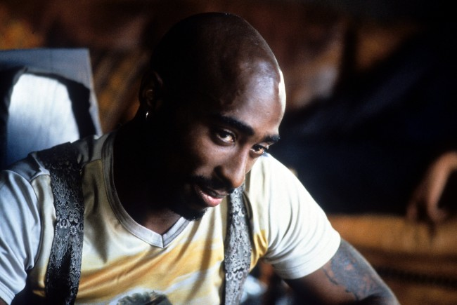 Tupac Shakur Is Still Alive After Conspiracy Theory Photo Discovered
