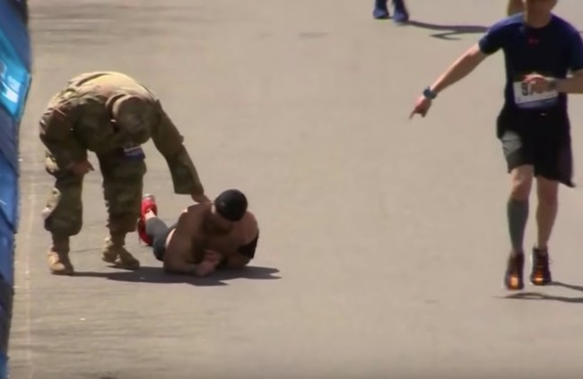 Marine Micah Herndon crawls across Boston Marathon finish line