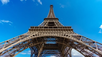 Lunatic Puts Eiffel Tower On Lockdown After He Attempts To Scale Paris' Tallest Structure Without A Rope (Pics + Vid)