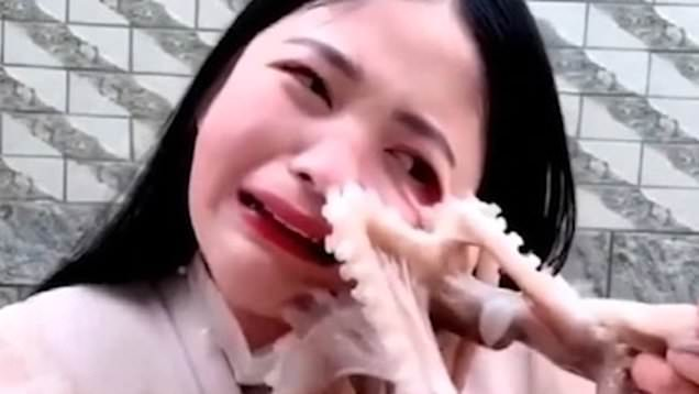 vlogger tries to eat live octopus sucks onto womans face