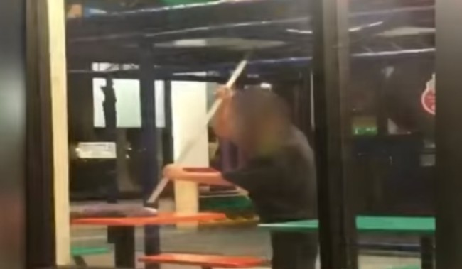 Burger King employee caught on video cleaning restaurant tables with a mop.