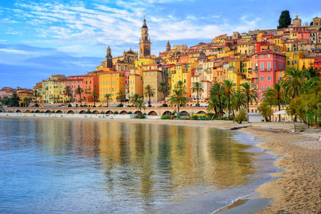 Sand beach beneath the colorful old town Menton on french Riviera, France