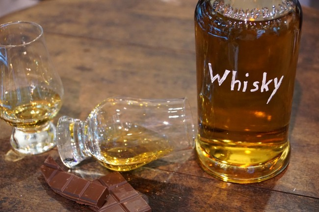 does whiskey age in the bottle