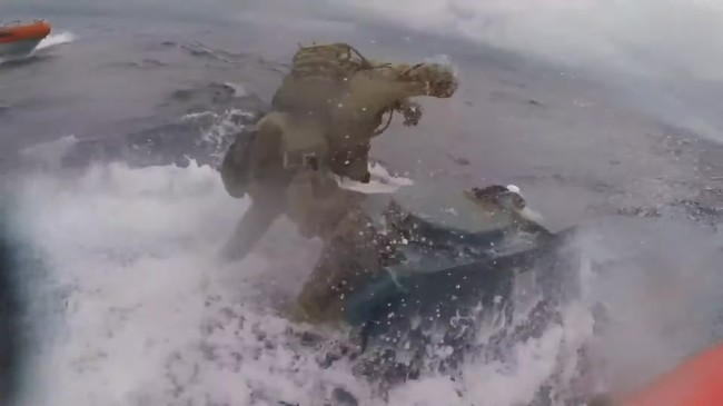 Coast Guardsman Jumps On Submarine Bangs On Hatch In Middle Of Chase