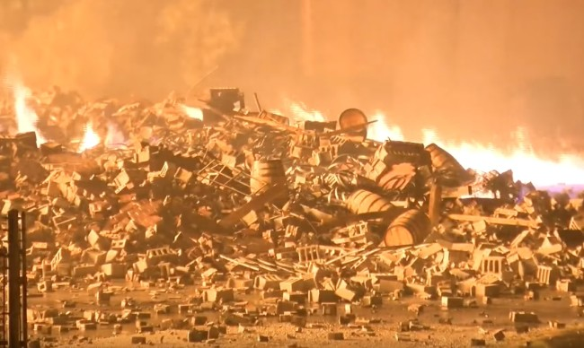 Fire burns down two Jim Beam warehouses and destroys over 45,000 barrels of bourbon worth as much as $330 million.