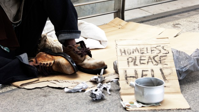 homeless man donation on street in the capital city.