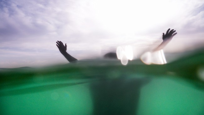 drowning person in the sea