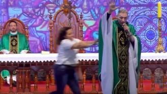 Woman Viciously Shoves Anti-Gay Priest Off The Stage While Delivering Sermon In Front Of 50,000 People
