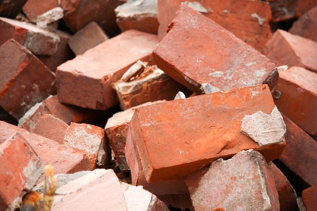 football player bulks up bricks backpack