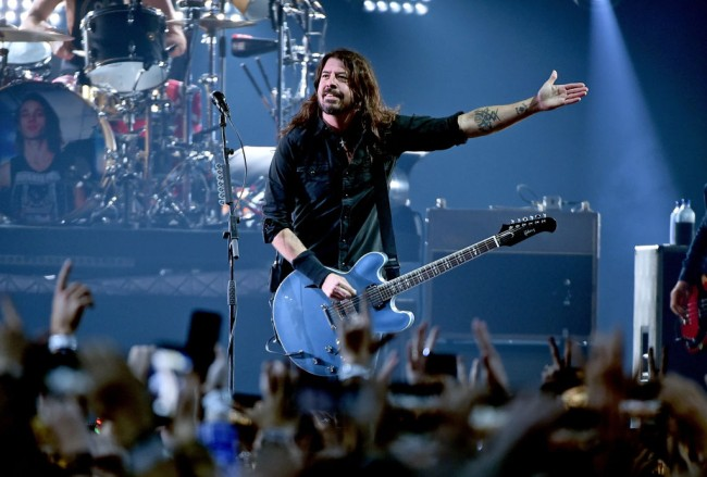 While closing out the Sziget Festival in Budapest on Tuesday, August 13, Foo Fighters frontman Dave Grohl invited a fan in a wheelchair to join the band on stage during the last song