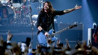 Watch Dave Grohl Invite A Foo Fighters Fan In Wheelchair To Crowdsurf Onto The Stage And Throw A Guitar