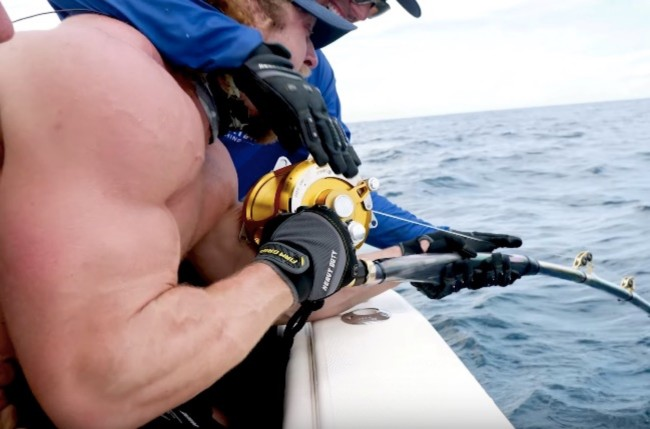 weightlifters fishing for giant Goliath Grouper