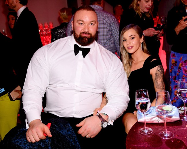 Hafþór Júlíus Björnsson AKA The Mountain from Game of Thrones bench pressed his wife Kelsey Henson while getting a tattoo.