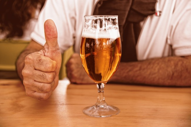 glass of beer and thumbs up