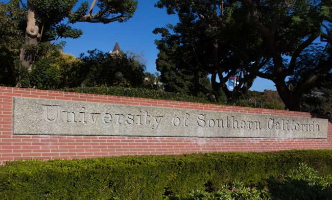 Los Angeles business executive Devin Sloane was sentenced to four months in prison for paying $250,000 to get his son admitted to the University of Southern California as a fake water polo recruit.