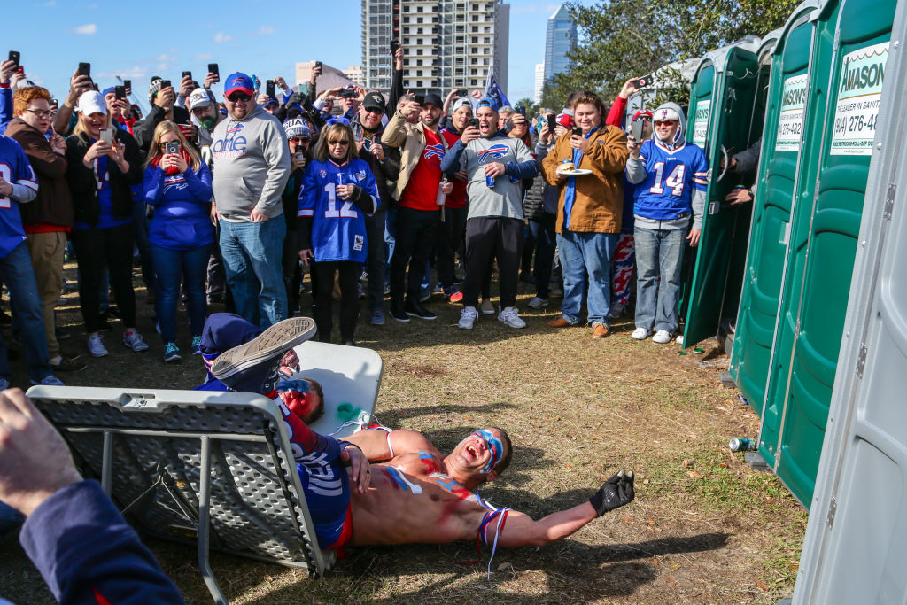 A Member Of Bills Mafia Got Knocked The Hell Out After Trying (And Failing)  To Jump Through A Table - BroBible