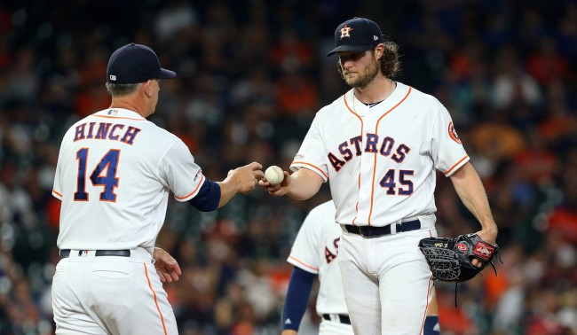 HOUSTON, TEXAS - AUGUST 28: Gerrit Cole #45 of the Houston Astros hands the ball to manager AJ Hinch #14 as he ties his season high with 14 strikeouts against the Tampa Bay Rays at Minute Maid Park on August 28, 2019 in Houston, Texas. (Photo by Bob Levey/Getty Images)