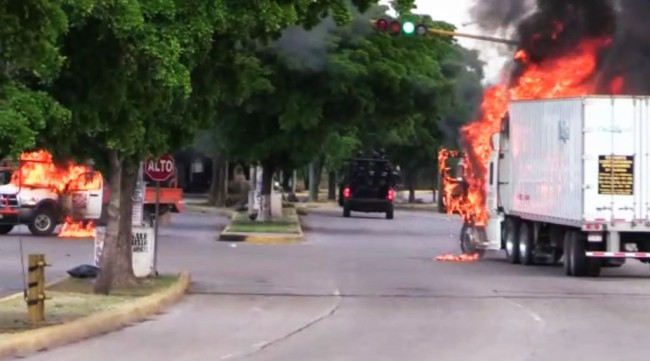 "Videos show gun battles and trucks burning in a street of Culiacan. Ivan Guzman, son of jailed drug kingpin Joaquin ""El Chapo"" Guzman of the Sinaloa Cartel arrested."