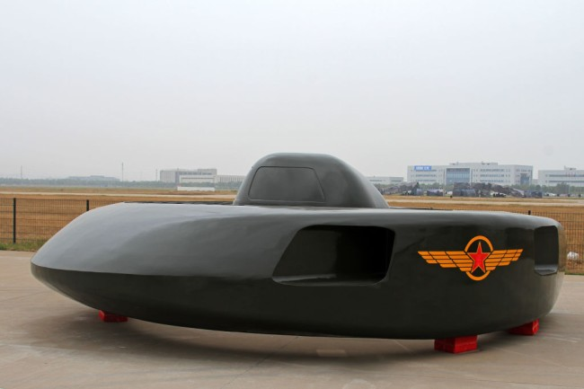 Experimental attack helicopter that looks like a UFO flying saucer unveiled in China. The strange stealth flying machine is called the Great White Shark and can travel at 400 MPH.