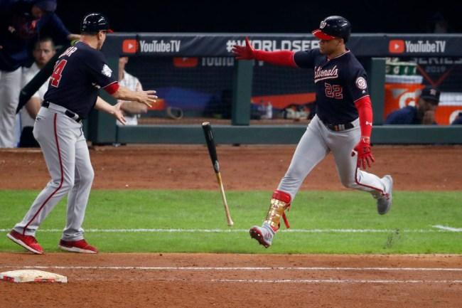 juan soto carries bat to first base