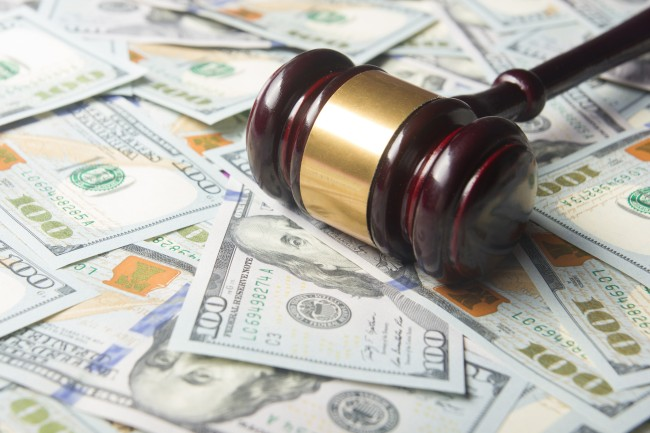 Auctioneer gavel on pile of cash