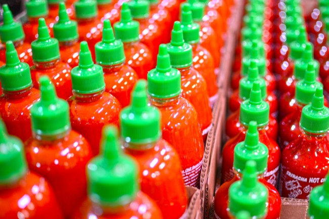 Four men were arrested after authorities in Australia seized 880 pounds of crystal meth worth about $210 million concealed in bottles of Sriracha hot chili sauce imported from the US.