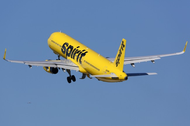 Drunk man pukes in woman's hair causing all of the passengers to disembark from Spirit Airlines plane and then man and woman are caught in bathroom causing another delay.