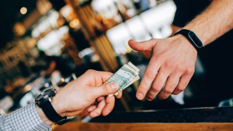 Here's The Proper Way To Tip Your Bartender Without Coming Off As A Total Jerk
