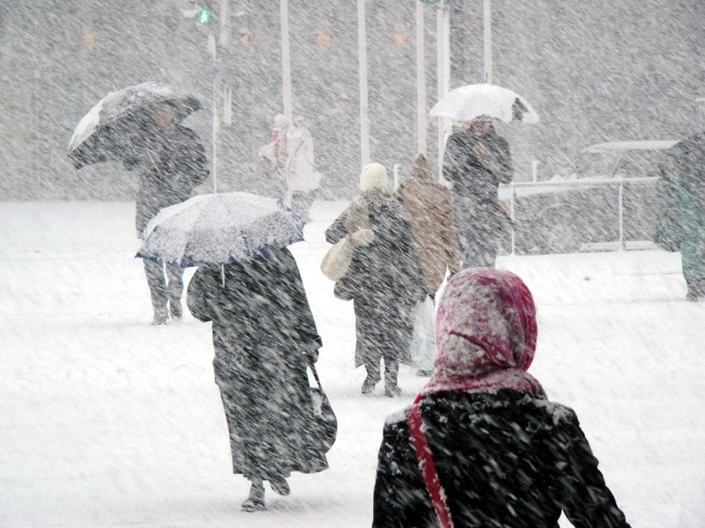 Arctic chill with snow hitting United States, bringing record cold temperatures to midwest, south, northeast. Winter weather alerts issued.