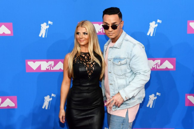 Mike The Situation Sorrentino and his wife Lauren Pesce buy $1.8 mansion in Holmdel, New Jersey. See the Jersey Shore star's new home.