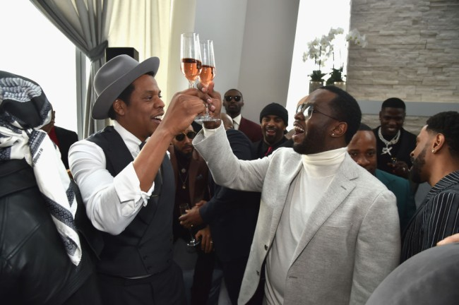 Jay-Z caught on video snatching someone's phone who was taking photos of him at Diddy's star-studded 50th birthday party.