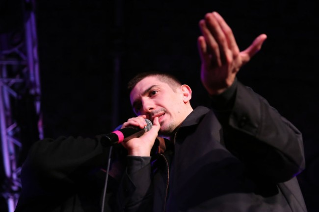 Comedian Andrew Schulz roasts father and daughter at stand-up comedy show in YouTube video.