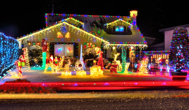 """A man in New Jersey decorated his home with Jeffrey Epstein-themed Christmas lights display, """"Epstein Didn't Kill Himself"""" the display reads."""