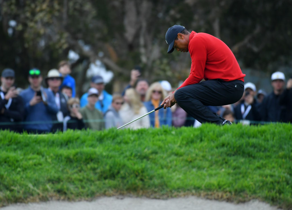 Tiger Woods extracted from vehicle and hospitalized after single-car crash