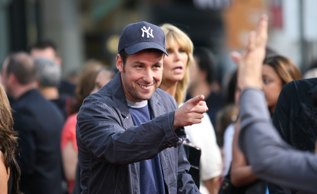 Adam Sandler's Twitter account was hacked by the same hackers who performed a cyber attack on Mariah Carey.