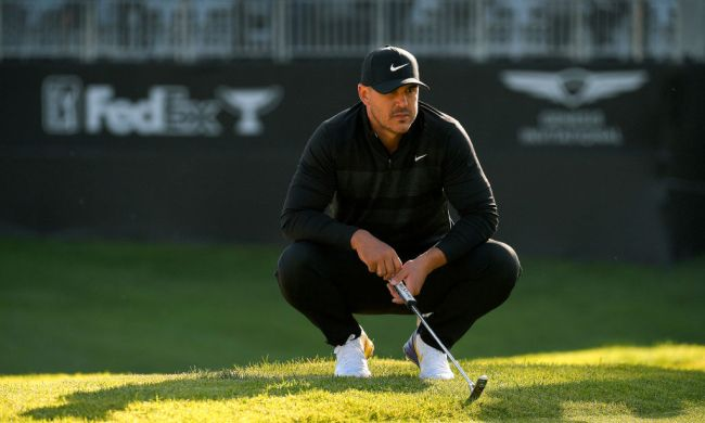 brooks koepka snapped irons over knee following missed cuts