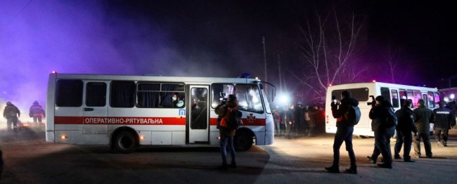 Buses carrying coronavirus evacuees attacked by protesters in Ukraine because of fake email.