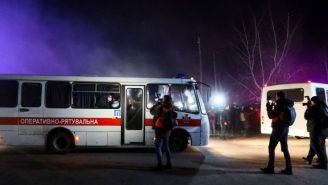 Riot Erupts As Protesters Attack Bus Transporting Coronavirus Evacuees After Hoax Email Goes Viral