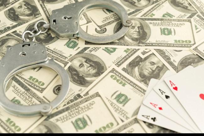 illegal gambling money handcuffs cards