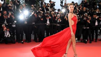Bella Hadid Urges People To Stay Inside By Going Topless With A Burrito
