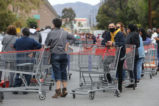 Costco and grocery stores see massive lines and brutal fights break out as panic sets in the United States.